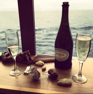 A glass of bubbly and a swiftly moving sea