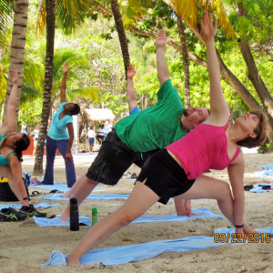 Yoga on the beach in Haiti. That's me in the pink.